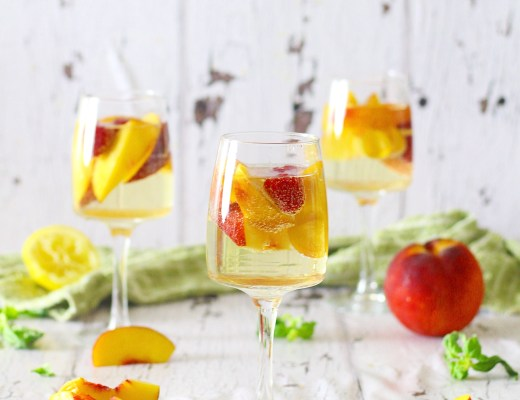 The perfect summer cocktail, this Ginger Peach Sangria is refreshing and sure to satisfy you on even the hottest of days!