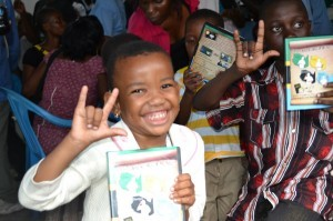 "An African child signs ""I Love You"" in gratitude for the Gospel DVD he received from DOOR. (Photo cred: DOOR)"