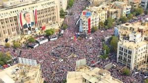 A picture released by the Syrian Arab News Agency (SANA) showing supporters of Syrian President Bashar al-Assad take part in a pro-regime rally in Damascus (October 2011)