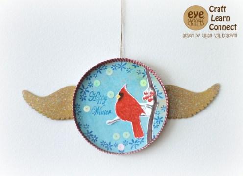 DIY winter ornament craft project idea featuring a beautiful red cardinal.