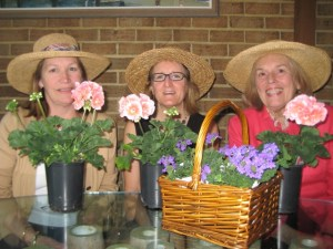 From left, Four River Garden Club members Charlotte Pennington, Kim Morrow and Lisa Sherwood prepare annual as well as perennial pottings for the club's annual Flower Mart which will begin at 8:30 a.m. Tuesday, April 30, at the Market House in downtown Annapolis.  A tradition for 65 years, the mart offers native plants and perennials from members' gardens, herbs, hanging baskets and cut flowers.   Club members will fashion May baskets from cut flowers and, for the first time, offer expert advice on flower arrangement for the novice gardener.   Arranging workshops are scheduled for 9 a.m. and 10 a.m. for fees of $25 to $35. Call 410.757.5867 to register. Flower mart proceeds support community gardening projects as well as local historic houses and gardens.