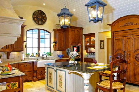blue and yellow kitchen with an awesome rooster 700x545