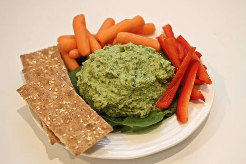 light but creamy spinach-artichoke hummus to use as a dip or spread!