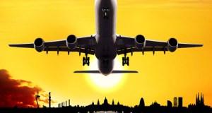 jumbo jet airplane landing at sunset