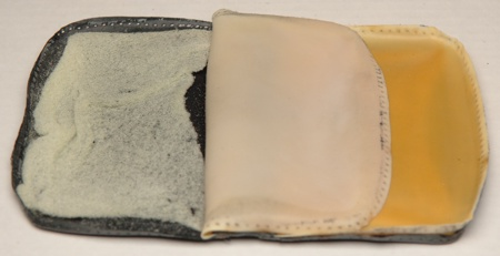 Padding and latex layers lining the leather exterior