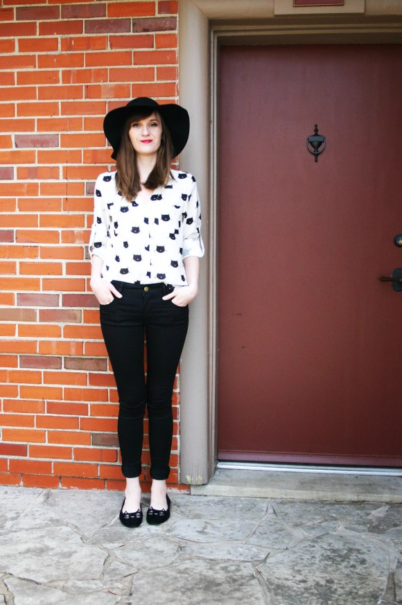 Emily from Fashion By Committee- SheIn cat print blouse and cat flats, American Eagle black skinny jeans, Kohls black floppy hat