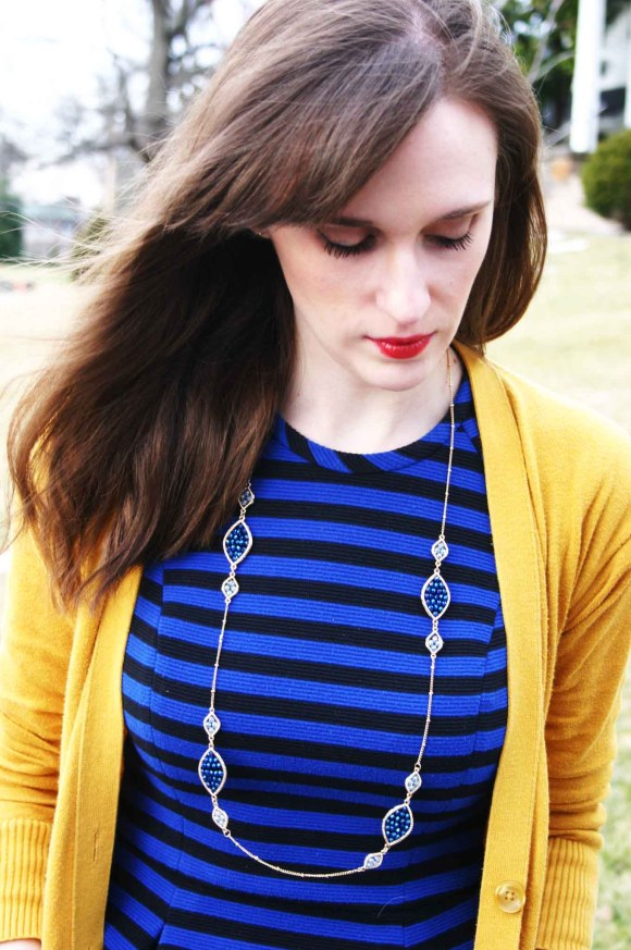 Emily from Fashion By Committee- Banana Republic blue and black striped dress, Target mustard cardigan, Francesca's necklace, Kohl's Dolce by Moxie nude bow pumps