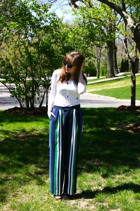 Emily from Fashion By Committee- Banana Republic wide leg striped trousers, Francesca's long blue and white eye necklace, Call it Spring sunglasses, Target long sleeve white tee and wedges