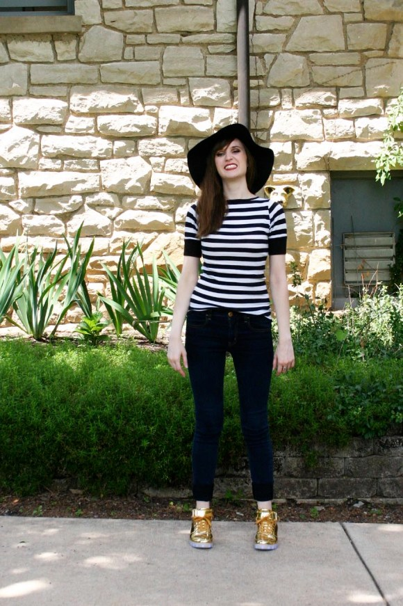 Emily from Fashion by Committee- Odema gold, light up high top sneakers, American Eagle jeans, Call it Spring sunglasses, Kohl's black floppy hat, black and white striped shirt of undetermined origin