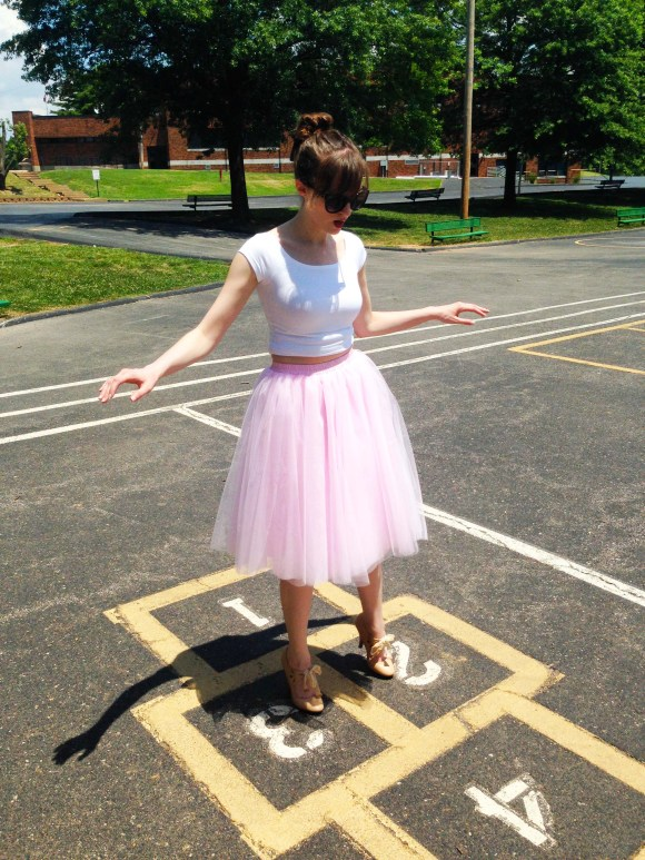 Emily from Fashion By Committee- Amazon tulle midi skirt, Express crop top, Charming Charlie sunglasses, Forever 21 crown ring, Kohl's nude bow shoes