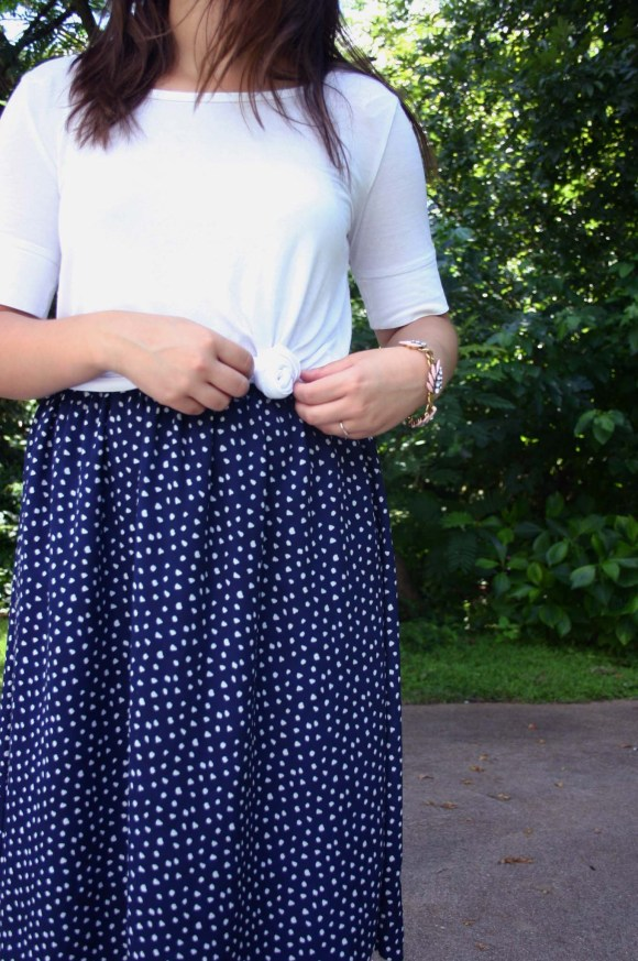 Jeanne FBC navy-white-polka-dot-midi-skirt-hm-white-tee-shirt-target-lunea-sneakers-rose-sunglasses-pink-statement-bracelet 2