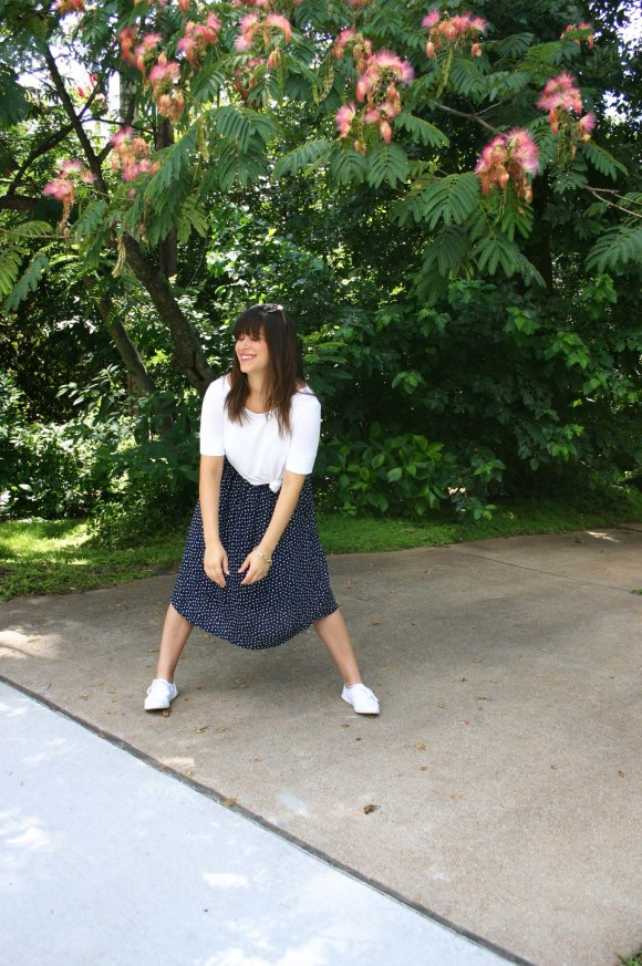 Jeanne FBC navy-white-polka-dot-midi-skirt-hm-white-tee-shirt-target-lunea-sneakers-rose-sunglasses-pink-statement-bracelet