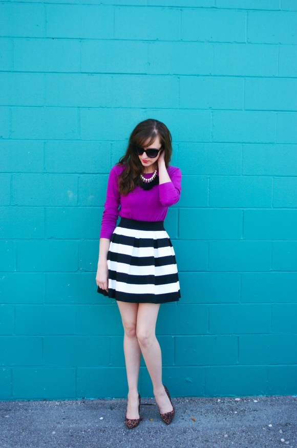Emily from Fashion By Committee- JCrew fuchsia crew neck sweater, Express black and white striped fit and flare mini skirt, Charming Charlie glossy black cat eye sunglasses, Target black and gold tassel fringe necklace, Target Sam & Libby leopard print heels