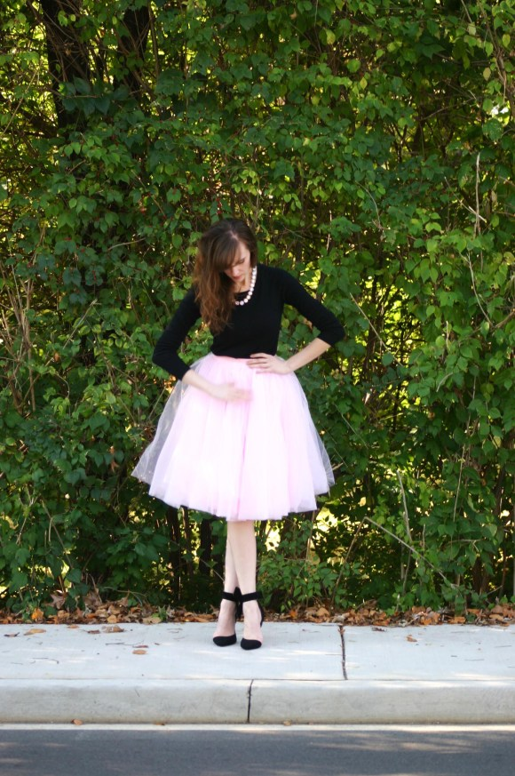 Emily from Fashion By Committee- Amazon tulle midi skirt, Target Mossimo black crew neck sweater, JCrew iridescent and gold necklace, SheIn bow pumps