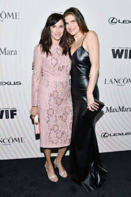 BEVERLY HILLS, CA - JUNE 13: Michaela Watkins (L) and Lake Bell, wearing Max Mara, attend the Women In Film 2018 Crystal + Luc