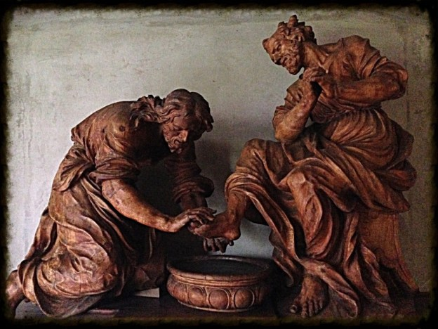 Jesus washes the feet of Jesus - wood carving in the cloister of Heiligenkreuz Abtei near Vienna