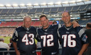 Westfield resident Joe Bucko and his two sons, Joseph and John, watch Patriots' practice inside Gillette Stadium on Friday, Aug. 1.