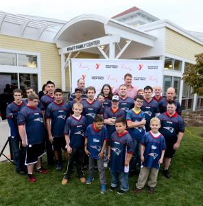 2014 Legends Ball Honoree New England Patriot Nate Solder with the Hockomock Y's Unified Flag Football team and former Legends Award Honoree and New England Patriot Hall of Famer Steve Grogan at the Invensys Foxboro Branch Kraft Family Center - Local News