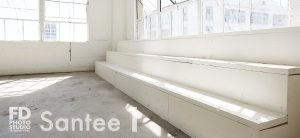 natural light photo studio with white staircase