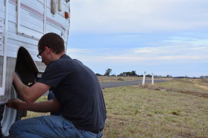 Matt changing the camper tyre - a success!