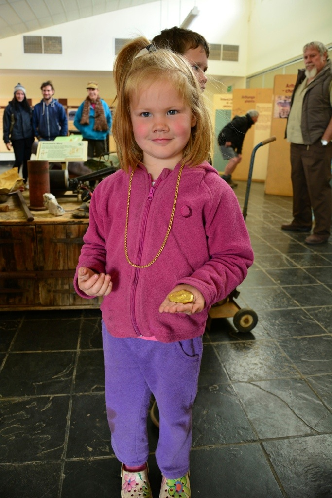 Lex getting to wear the gold necklace and gold nugget at the Visitor Centre - she thought she was getting to keep them - hehehehe - the look on her face when she had to give them back!