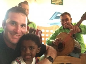 Reflecting on a new focus of strengthening relationships: Aaron Blank with his son, Ermias, at a restaurant in Mexico during the holidays.