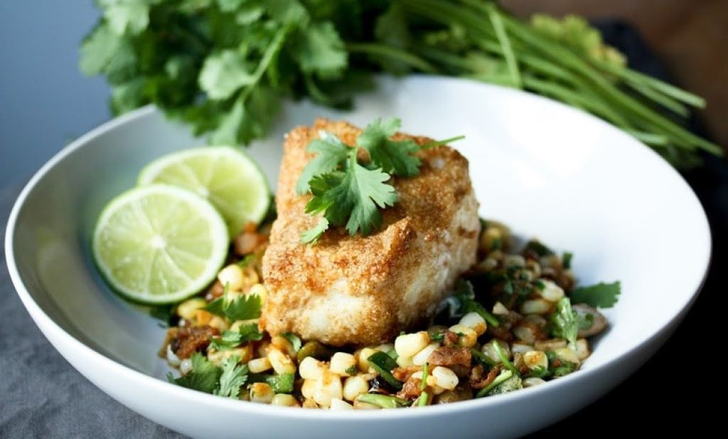Cornmeal Crusted Fish ( or TOFU) with Fava Bean and Summer Succotash, and lime and cilantro - a delicious meal using fresh farmers market ingredients.   www.feastingathome.com