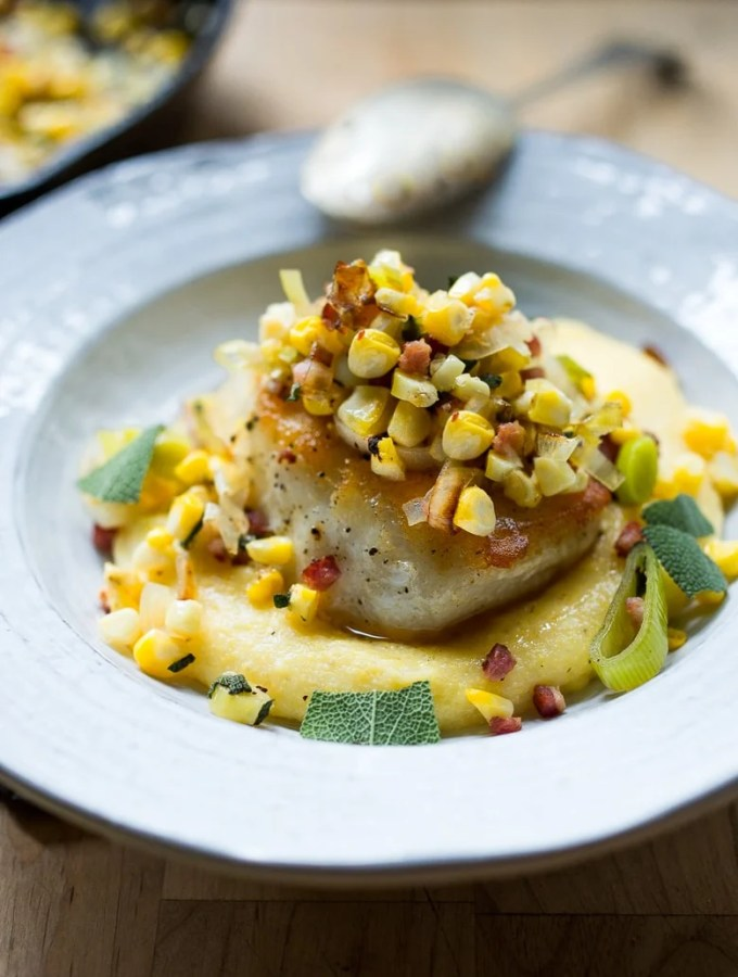 Halibut with Corn, leeks, pancetta over a lightened up Creamy Polenta| feasting at home