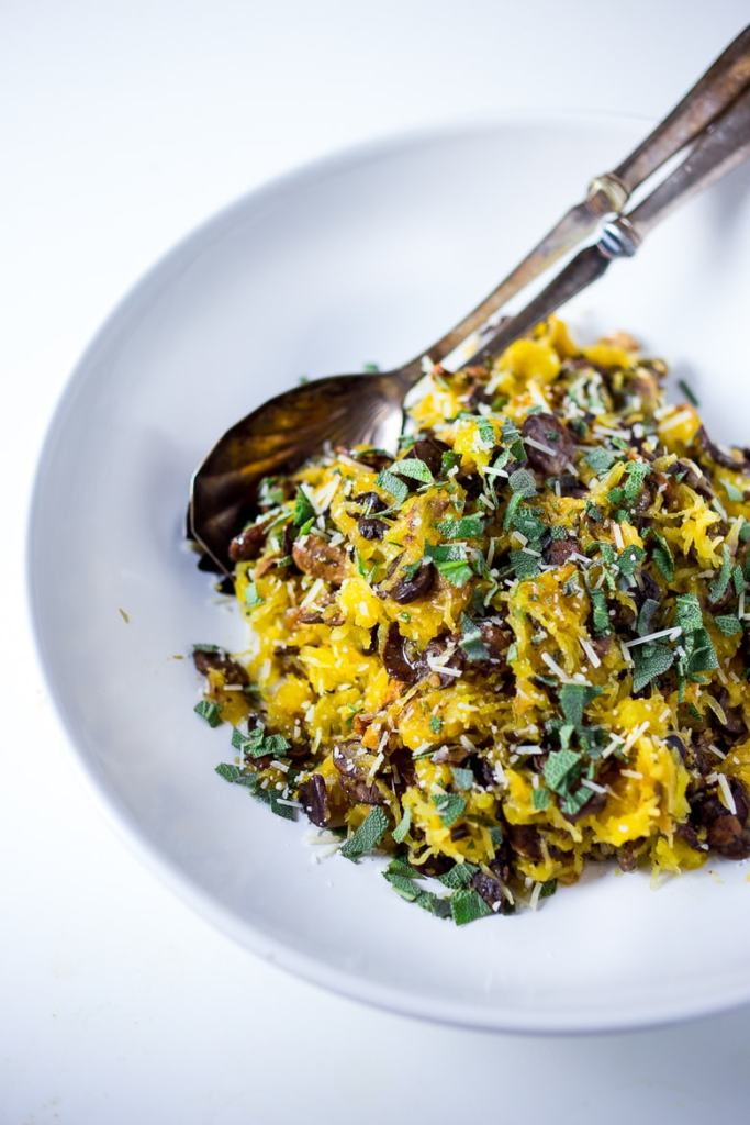 A healthy and delicious recipes for Roasted Spaghetti Squash with Mushrooms, Garlic & Sage--- easy to make and full of flavor. The perfect side dish for fall.   feastingathome.com