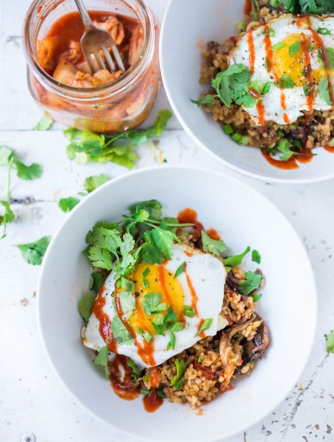Kimchi Rice- a healthier take using brown rice , seasonal veggies and less oil! | www.feastingathome.com