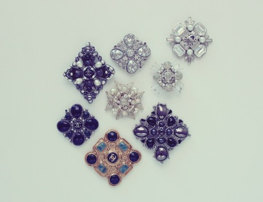 Various Chanel brooches
