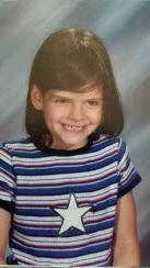 1st grade. Yes, I still have that evil grin.