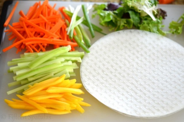 fresh ingredients: carrots,cucumber, scallions, mango, lettuce for spring rolls