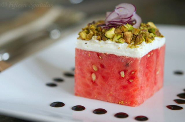 stacked watermelon salad with goat cheese, pistachios, red onion, balsamic