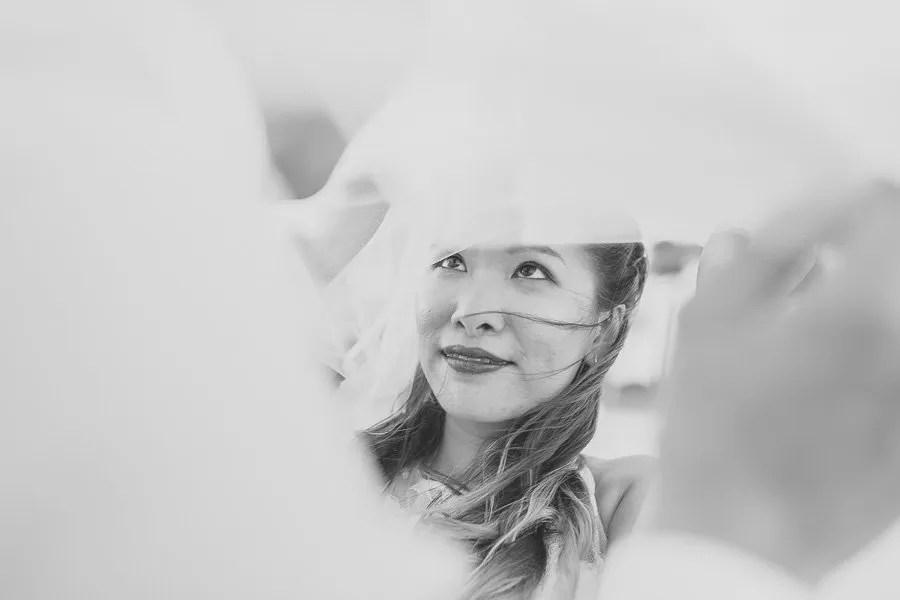 bride looking at groom under her veil at their key west wedding