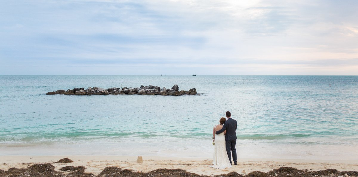 married couple looking at the ocean on key west beach
