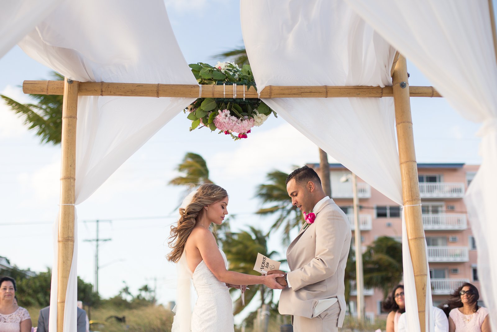 couple at the wedding altar on the beach in key west, fl