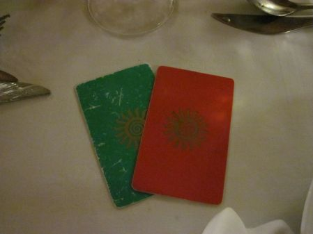 "Dinner at the Bahai Principe's Brazilian Steakhouse. Red means, ""I'm all set."" Green means, ""Bring on the meat!"""