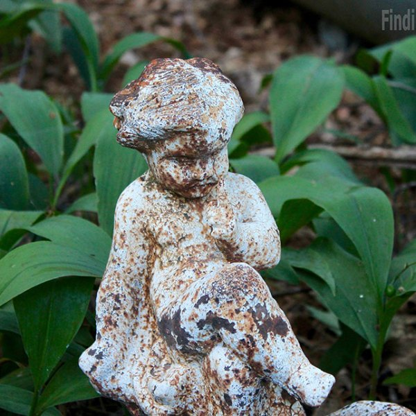 rusted statue of a baby