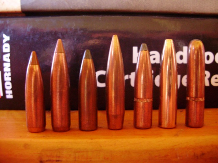 This photograph depicts only a small selection of available .264 projectiles suitable for the 6.5x55mm. From left, 100- and 120-gr Nosler Ballistic Tips, 120-gr Sierra Pro-Hunter, 123-gr Sierra Matchking, 129-gr Hornady Interlock Spire Point, 140-gr Woodleigh Weldcore and 160-gr Hornady Interlock round nose. The Noslers are designated hunting, not varmint bullets, but are suitable for small game. The Matchking is a serious long-range target bullet, but also good for small game. The Pro-Hunter and Interlock Spire Point work great on medium game while the Weldcore and Interlock round nose are best reserved for larger deer species, at moderate ranges.