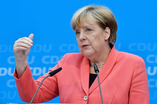 German chancellor Angela Merkel of the Christian Democratic Union (CDU) speaks during a press conference one day after regional election polls in Berlin on September 19, 2016. The Christian Democratic Union (CDU) party was reeling after another stinging poll loss, as an upstart populist party poached votes in a Berlin state election by railing against her liberal refugee policy. / AFP PHOTO / John MACDOUGALL