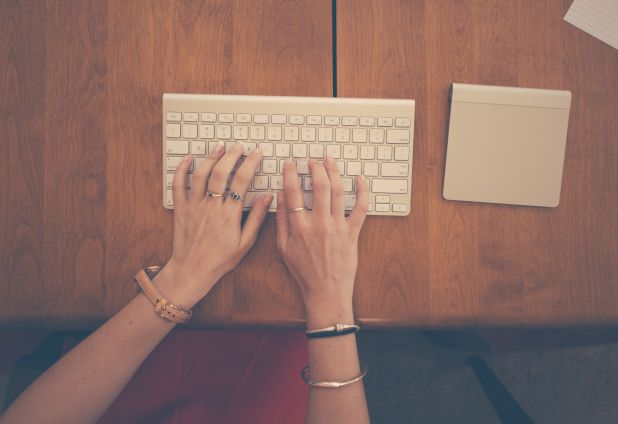 Business Woman Typing On Keyboard With track Pad