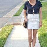 black tee with a cream mini skirt from @fizzandfrosting