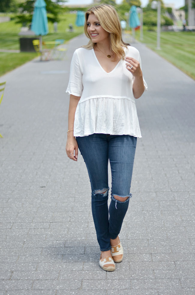 relaxed peplum top with distressed skinny jeans and tory burch espadrilles | www.fizzandfrosting.com