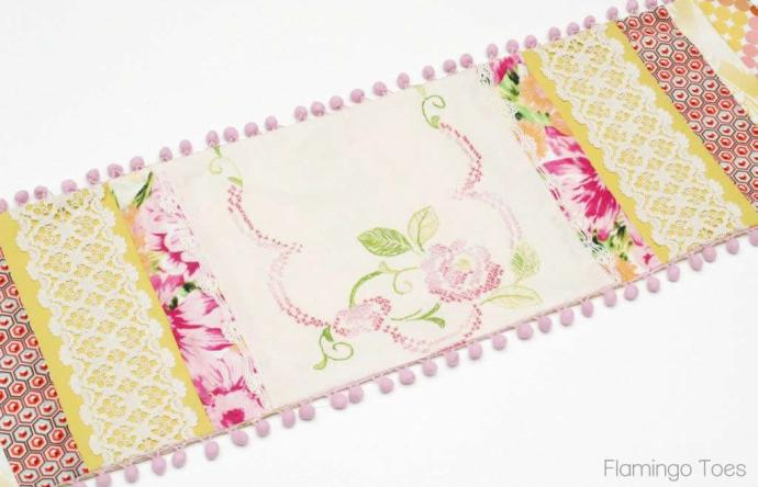 Patchwork Table Runner with pompoms