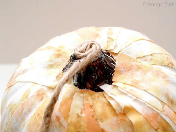 glueing twine to pumpkin