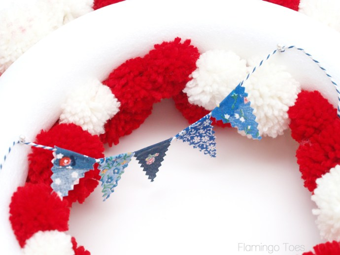 Pinning pennant to wreath