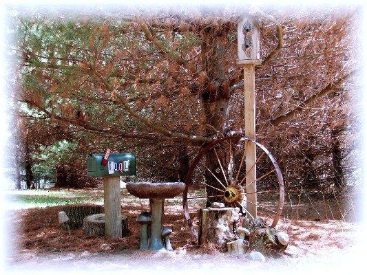 Secret garden vignette showing Jeanne's tool mailbox.