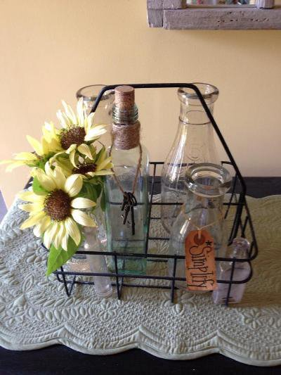 Kim Trudo's milk wire crate with vintage bottles and faux sunflowers