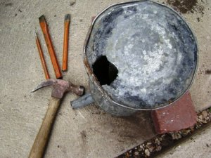 Hammer-n-chisel-makes-the-drainage-hole.